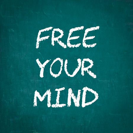 free your mind: FREE YOUR MIND written on chalkboard