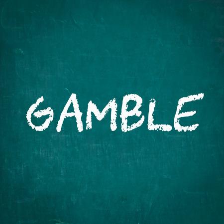 gamble: GAMBLE written on chalkboard