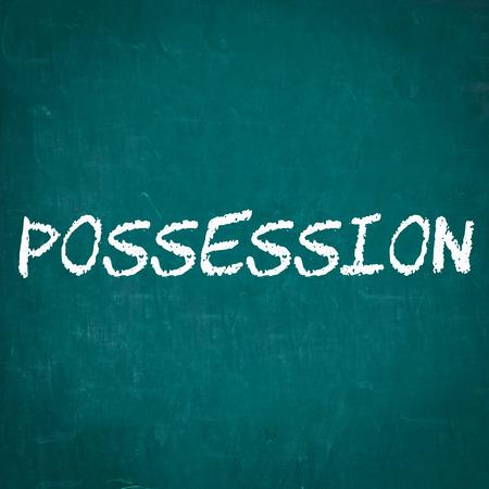 possession: POSSESSION written on chalkboard