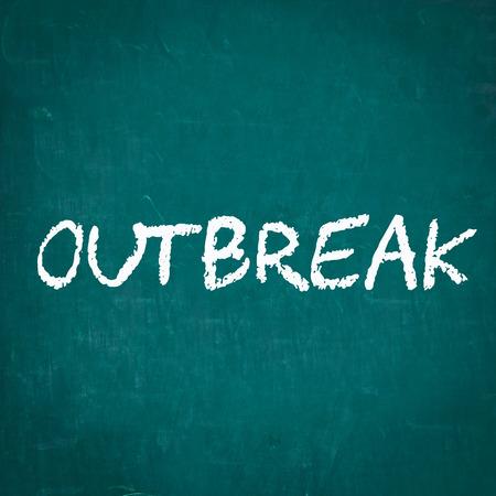 outbreak: OUTBREAK written on chalkboard