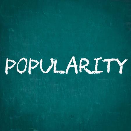 by popularity: POPULARITY written on chalkboard