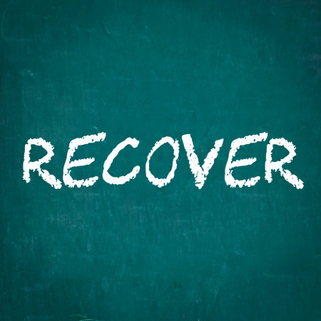 recover: RECOVER written on chalkboard Stock Photo