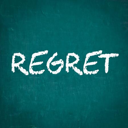 regret: REGRET written on chalkboard