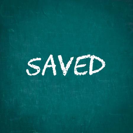 saved: SAVED written on chalkboard