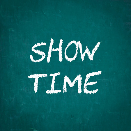 show time: SHOW TIME written on chalkboard Stock Photo