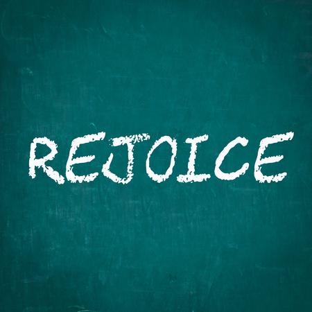 to rejoice: REJOICE written on chalkboard Stock Photo