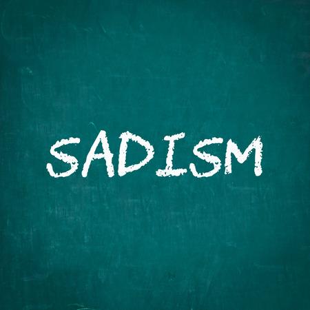SADISM written on chalkboard Stock Photo