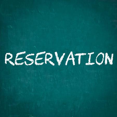 reservation: RESERVATION written on chalkboard