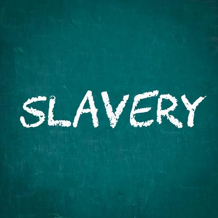 slavery: SLAVERY written on chalkboard