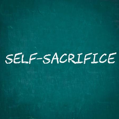 sel: SELF-SACRIFICE written on chalkboard