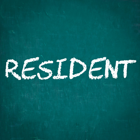 resident: RESIDENT written on chalkboard Stock Photo