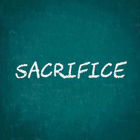 sacrifice: SACRIFICE written on chalkboard