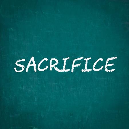 sacrificio: SACRIFICIO escrita en la pizarra