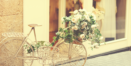 decorated bike: Vintage beautiful white vintage bicycle with flowers