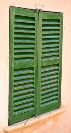 spanish style: Spanish style shutters in a old house