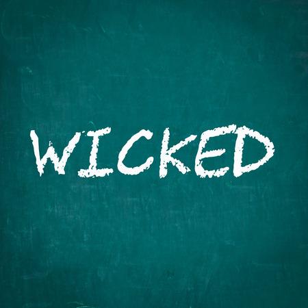 wicked: WICKED written on chalkboard