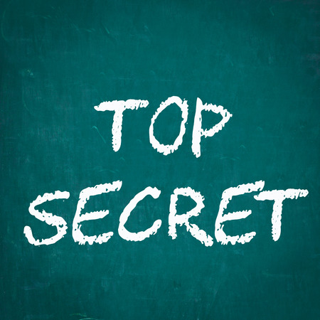 top secret: TOP SECRET written on chalkboard Stock Photo