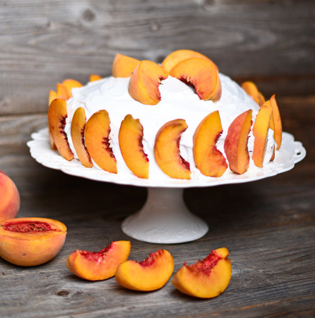 Fresh peach cake on wooden table