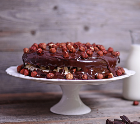 chocolate cakes: Delicious chocolate cakes with hazelnut on wooden table