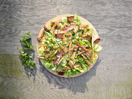 Fresh Ceaser salad on wooden table