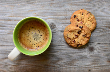 Coffee and cookies on wooden background