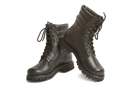 american downloads: Black leather army boots on a white background