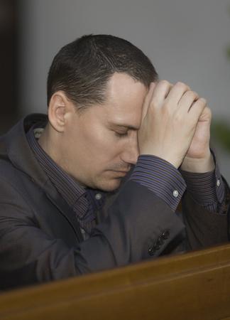 Man praying in church photo