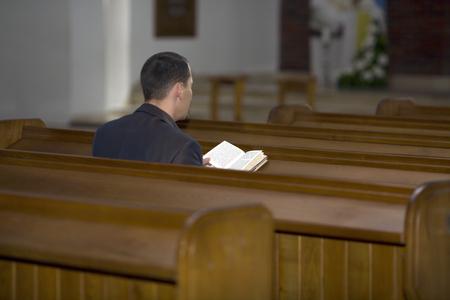 Man reading the Bible in church