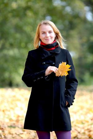 Woman in autumn park Stock Photo