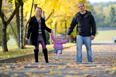 Happy family having fun outdoors Stock Photo