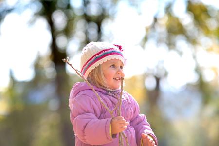 Child in autumn park Stock Photo