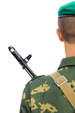 The man in a military boundary uniform with the weapon on a breast