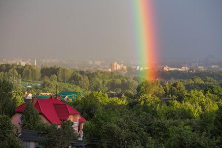 Rainbow on the city Stock Photo
