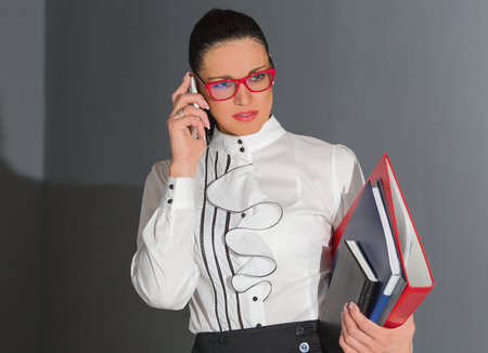 Woman talking by telephone