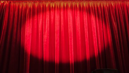 View of a red curtain through a monocular