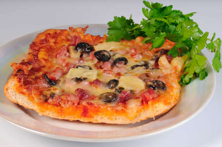 Pizza on the plate with parsley Stock Photo - 8689415