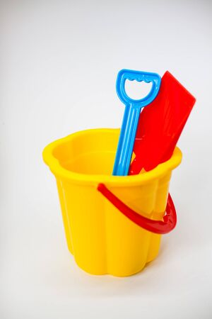 Bright children toys for playing in the sandbox on a white background Banque d'images