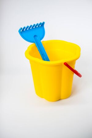 Bright children toys for playing in the sandbox on a white background