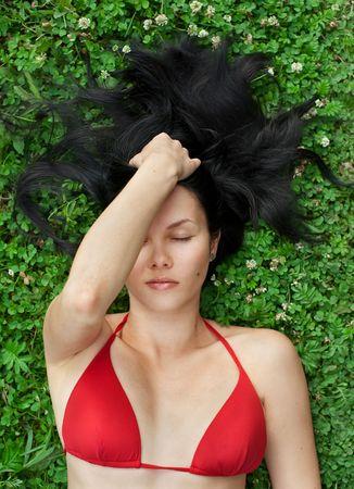 Beautiful Brunette with Long Dark Hair on Green Grass Stock Photo - 7968086