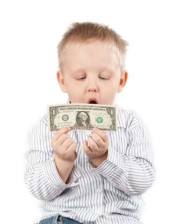Little boy holding money with a happy suprised look isolated on white photo