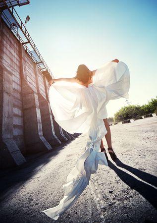Beutiful bride in wedding dress walking down the street Stock Photo - 8186268