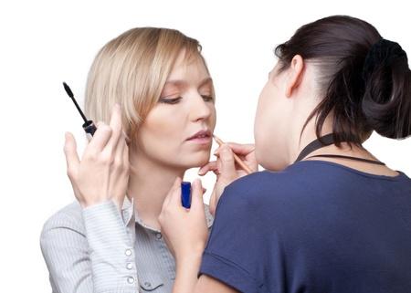 Professional make-up artist doing make-up using lip pencil photo