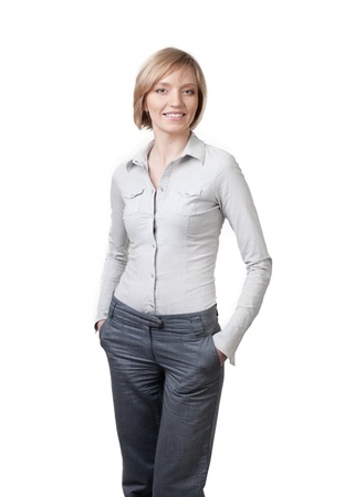 Smiling beautiful businesswoman with hands in pockets standing against isolated white background Stock Photo - 8278215