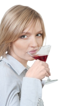 Portrait of a young beautiful woman enjoying cocktail isolated over white background photo