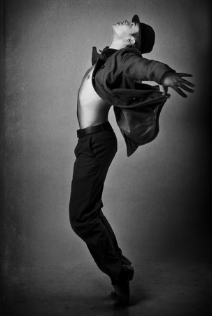 male costume: grunge image of handsome young dancer with bare torso (black & white)