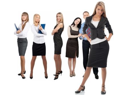 Confident business woman with colleagues standing in the background. Isolated on white Stock Photo - 10828340