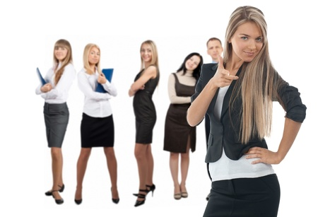 Confident business woman with colleagues standing in the background. Isolated on white Stock Photo - 10828295