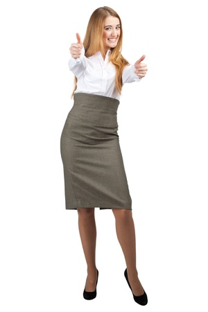 Full length portrait of happy young businesswoman showing thumbs up, isolated on white background photo