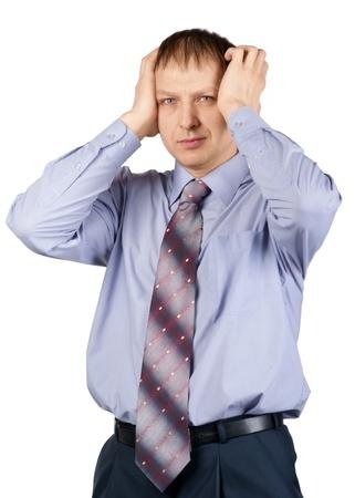 Portrait of a worried businessman having a headache against white background Stock Photo - 10828342