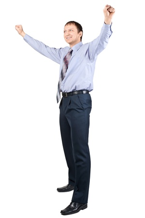 Full length portrait of cheerful businessman with hands raised in victory, over white background Stock Photo - 10826142